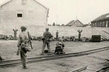 wide_Dachau_execution_coalyard_1945-04-29.jpg